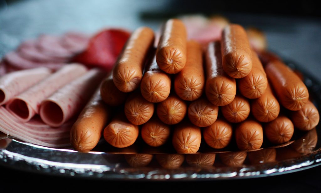 Is red meat ok to eat processed meat franks and ham sausage